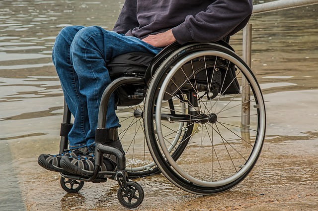 A image focussing on a wheelchair users legs and chair.